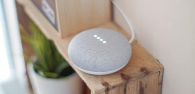 round grey speaker on brown board 1072851