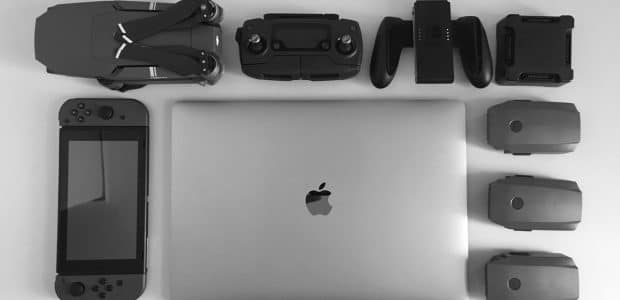 silver macbook surrounding black electronic devices 792345