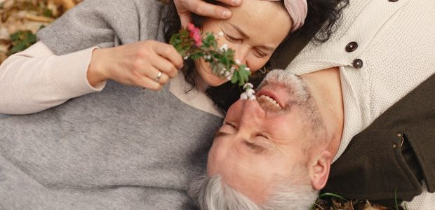 happy senior couple in love with bunch of fresh flowers in 4148984